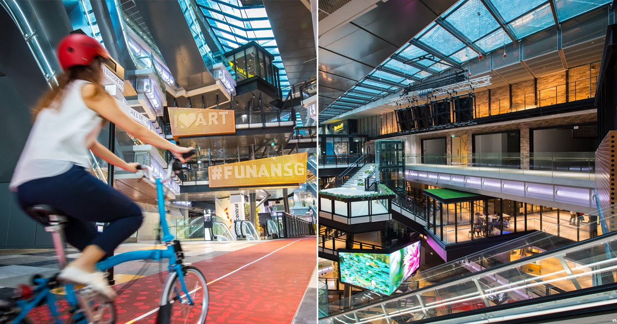 The new Funan Mall has an indoor cycling track, a rooftop farm and robot helpers